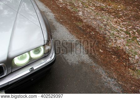 Chernigov, Ukraine - January 6, 2021: Old Car Bmw 7 Series (e38) On The Road In The Forest. Gloomy W
