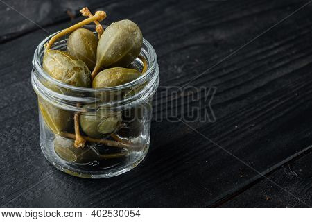 Capers, Marinated Capers, On Black Wooden Background With Copy Space For Text