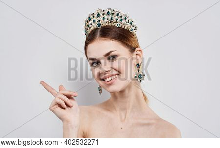 Emotional Woman With A Diadem On Her Head And Beautiful Earrings Model