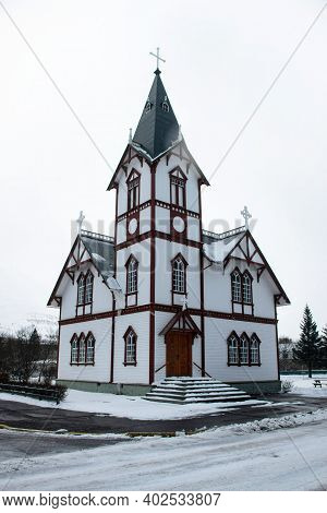 Winter Snow Panorama Of Wooden Steeple Church Husavirkurkirkja In Whale Watching Town Village Husavi