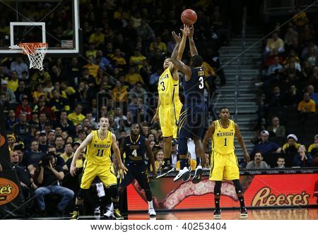 BROOKLYN-DEC 15: West Virginia Mountaineers guard Juwan Staten (3) shoots over Michigan Wolverines guard Trey Burke (3) during the first half at Barclays Center on December 15, 2012 in Brooklyn.
