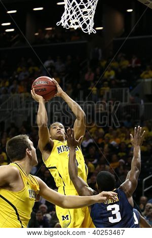 BROOKLYN-DEC 15: Michigan Wolverines guard Trey Burke (3) shoots against the West Virginia Mountaineers during the first half at Barclays Center on December 15, 2012 in Brooklyn.
