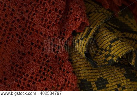 Old, Vintage Crocheted Red And Yellow Bedspread Or Shawl At A Flea Market