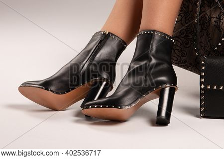 Girl In High-heeled Shoes. Fashionable Boots With High Heels. High Heel On Trendy Boots. Girl In Sho