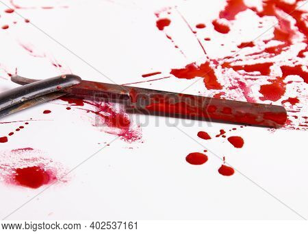 Blood Drops. Murder And Suicide Concept. Blood Trail And An Old Straight Razor. An Old Razor And Blo
