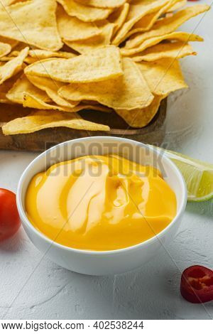 Bowl With Cheese Dip With Nacho, On White Background