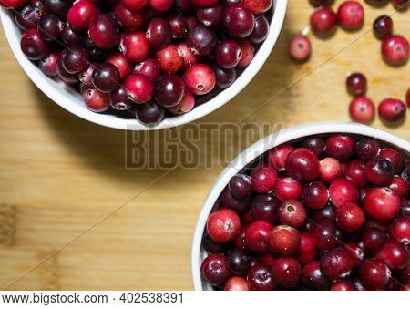 Red Berries Cranberries. Fresh Berries In Light Utensils On A Wooden Background. Berries. Vitamins.