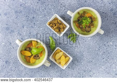 Healthy Delicious Vegetable Soup Puree With Carrot Chips And Croutons. Served On Grey Table Surface.