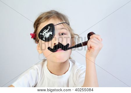 Little girl in white with pipeful, fake mustache and bandaged eye is pirate.