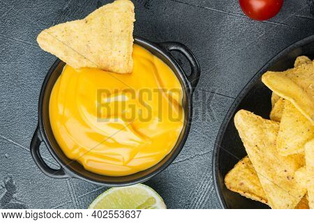 Nachos Corn Tortilla Chip With Cheese Dip Sauce, On Gray Background, Top View Or Flat Lay
