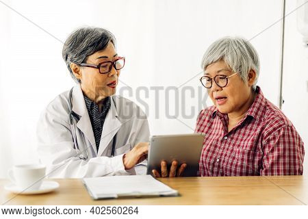 Doctor Consulting And Check Up Information With Senior Woman In Hospital.elderly Woman Has Sick.heal