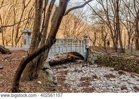 Jeongeup-si, South Korea; December 8, 2020: Concrete Footbridge Across Rocky Dry Stream At Naejangsa