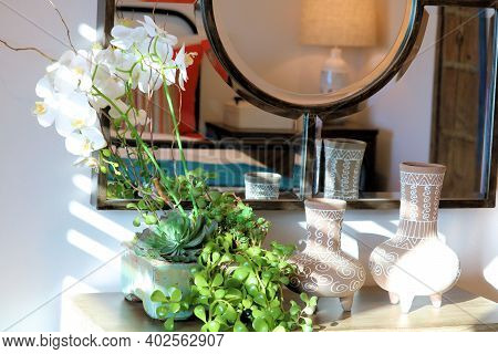 Orchid Flowers In A Vase On A Bathroom Counter Besides A Mirror Taken At A Residential Home