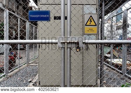 Transformer Station In The Chain-link Fence Security Around And Area Danger Keeps With Warning Sign