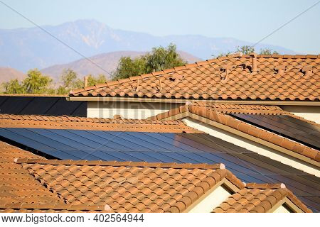 Solar Panels On A Rooftop Of Residential Buildings Creating Green Alternative Energy Taken In An Urb