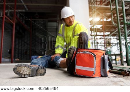 First Aid Support Accident At Work Of Construction Worker At Site. Builder Accident Falls Scaffoldin