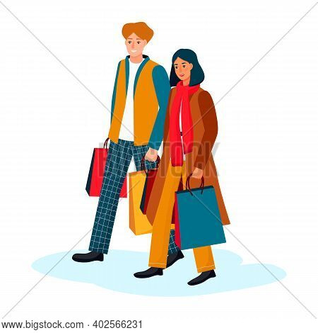 Happy Couple Go With Paper Shopping Bags. Young Stylish Man Woman Go For Gifts. Guy And Girl In Autu