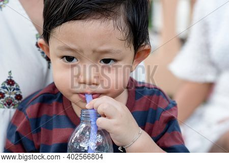 Portrait Of Asian Little Boy While Water Drinking After Playing At The Park On The Playground For Ki