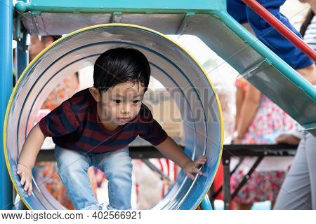 Asian Boy Portrait Enjoy, Little Boy Playing At The Park On The Playground For Kids & Children With