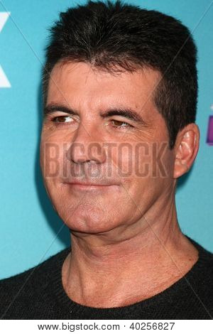 .LOS ANGELES - DEC 17:  Simon Cowell at the 'X Factor' Season Finale Press Conference at CBS Television City on December 17, 2012 in Los Angeles, CA