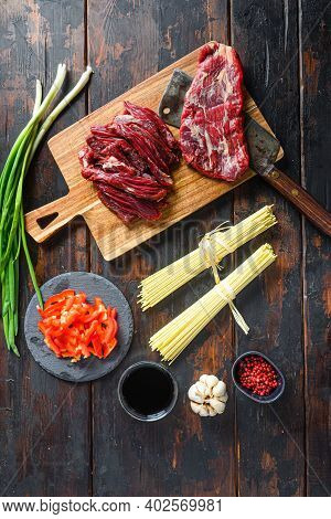 Cooking Components For Making Stir-fried Yakisoba With Beef. Flap Steak And Noodles On Wooden Backgr
