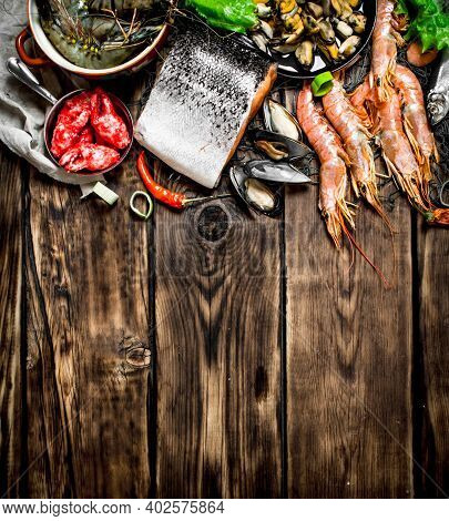 Fresh Seafood. A Variety Of Seafood From Shrimp, Shellfish And Other Marine Life. On Wooden Backgrou