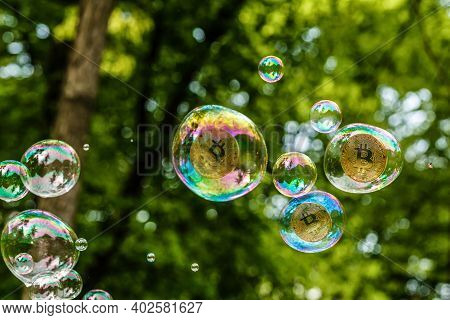 Gold Coins Bitcoin In A Soap Bubble. The Concept Of Instability Of The Crypto Currency, Electronic M
