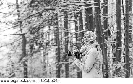 Christmas Fun. Woman Use Vintage Camera. Hobby Time Outdoor In Winter Day. Admiring Winter Mountain