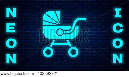 Glowing Neon Baby Stroller Icon Isolated On Brick Wall Background. Baby Carriage, Buggy, Pram, Strol