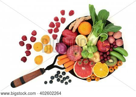 Fruit and vegetables high in antioxidants that neutralise free radicals also high in fibre, anthocyanins, carotenoids, lycopene, vitamins and minerals. Immune boosting health food concept.
