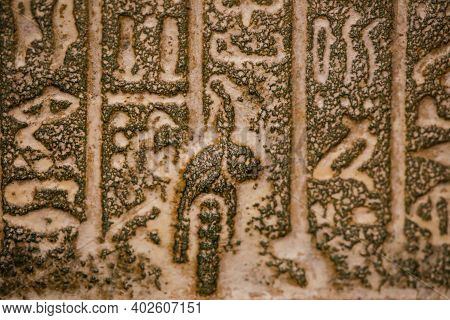 Shallow Depth Of Field (selective Focus) And Close Up Footage With Egyptian Hieroglyphs On A Histori
