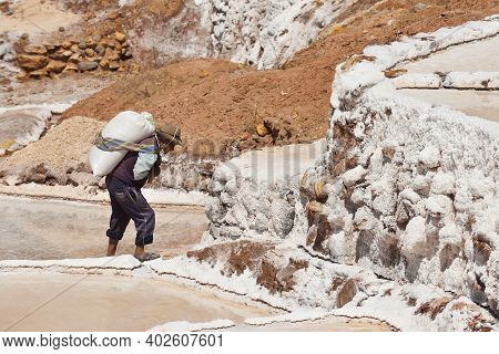 Maras, Peru - September 03, 2016: Unidentified People Work At Salt Evaporation Ponds At The Maras Sa