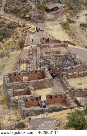 Pisac, Peru - September 04, 2016: Unidentified People Walking In Inca Structures In The Urban Sector