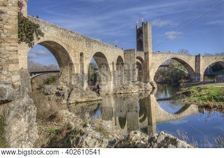 Fluvia Riverside With Medieval Bridge At Bottom, Besalu. Garrotxa, Girona, Catalonia, Spain