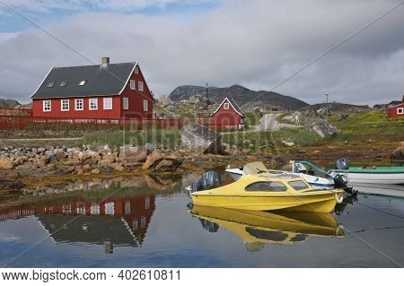 Architecture And Colorfull Houses In Small Town Of Nanortalik In Greenland Together With His Wild An