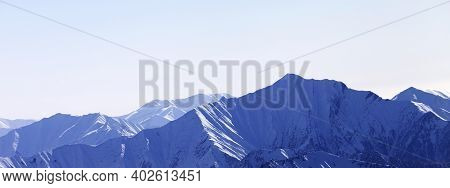 Panoramic View On High Snow Mountains In Haze. Winter Mountains In Early Morning. Georgia, Region Gu