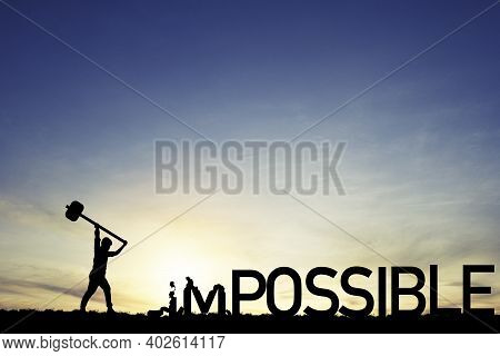 Mindset Concept ,silhouette  Man Smashed With A Hammer To Destroy Impossible To Possible  Wording On