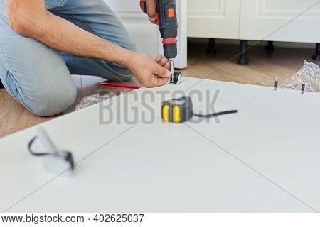 Close Up Detail Of Furniture And Hands Of Carpenter Worker With Professional Tool, Screwdriver In Ha