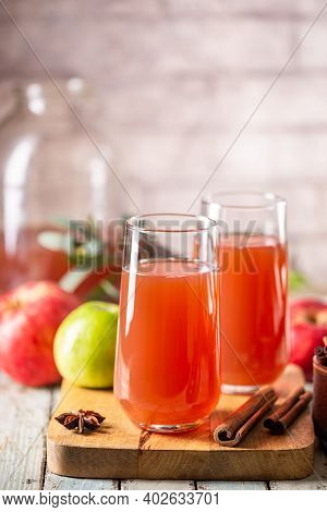 Glass Of Fresh Apple Juice And Red Apples On Wooden Background