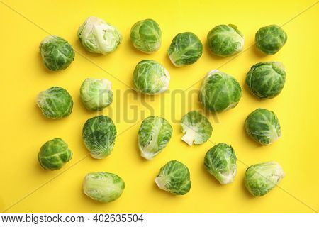 Fresh Brussels Sprouts On Yellow Background, Flat Lay