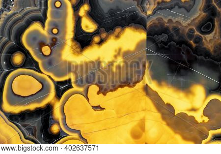 Black-yellow Agate In Cutaway With Internal Lighting. Background And Texture Of Natural Agate.