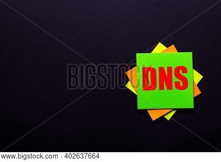 Dns On A Bright Sticker On A Dark Background. Copy Space