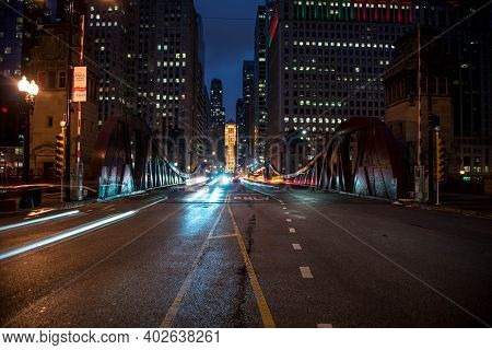 Chicago, Il December 16, 2020, Car Light Trails At Night, Looking Over The Lasalle Street Bridge Tow