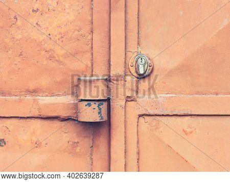 Red Locked Old Metal Door. Massive Lock Case On Latch And Lock Insert. Industrial Sheet Metal Doors