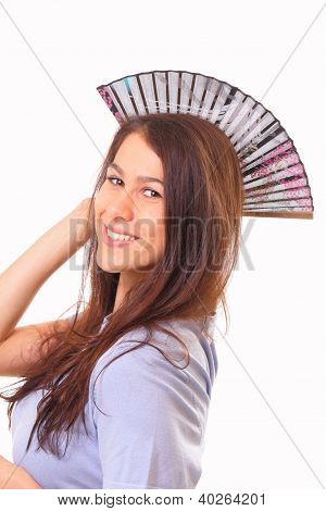 Smiling Young Woman With A Fan