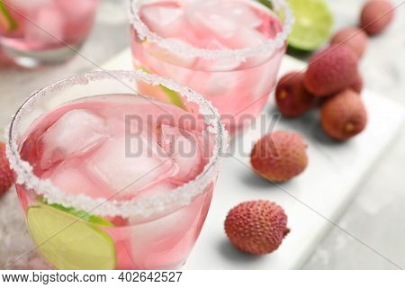 Lychee Cocktail With Lime And Ice On Table, Closeup