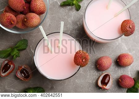 Flat Lay Composition With Lychee Cocktail On Grey Table, Closeup