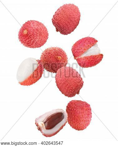 Set Of Falling Delicious Lychees On White Background