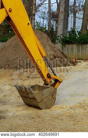 Under Construction With Excavator Bucket On In During Earthmoving Works