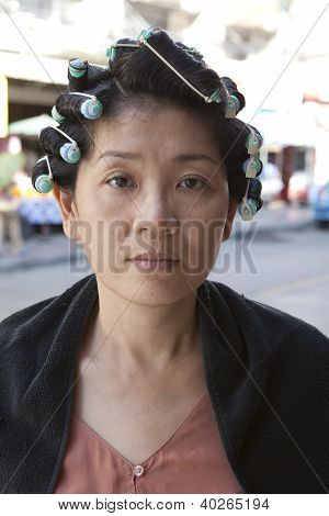 face of asian woman rolling hair curl